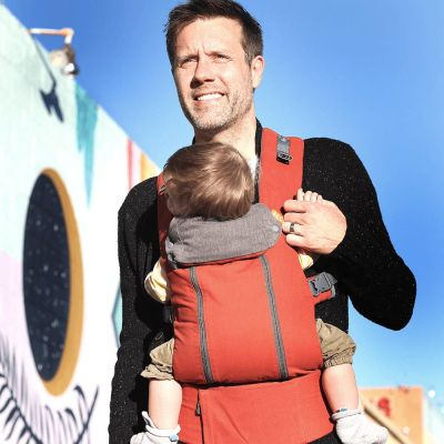 Beco 8 Baby Carrier Rust Charcoal used by father to front carry son