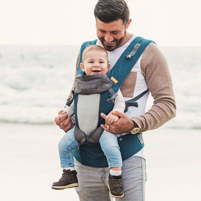 Beco 8 Teal Charcoal Baby Carrier used by father to carry son in front facing position at the beach