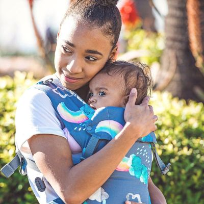 Beco Gemini Baby Carrier Over The Rainbow used by lady to hug her baby