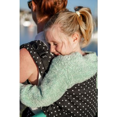 Beco Toddler Carrier Geo Teal Blue used by mother on day out to the beach