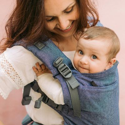 Baby smiling in a Boba X Grey Carrier