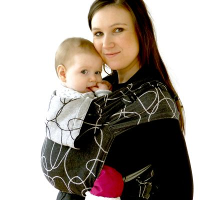 Didymos DidyTai Mei Tai Wrap conversion Baby Carrier Ellipses Black used by lady to carry her baby in front carry