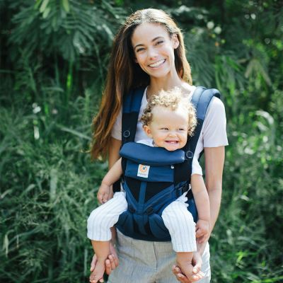 Ergobaby Omni 360 Cool Air Mesh Baby Carrier Pearl Grey used by lady to forward face carry baby