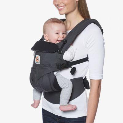 Ergobaby Omni 360 Cotton Baby Carrier Charcoal used by lady to front carry baby