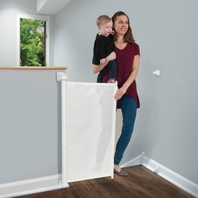 KidCo Retractable Safeway Gate White at top of stairs