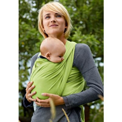 Lady using a bellybutton by Manduca Carrier Berry Dots with a baby about 6 months old