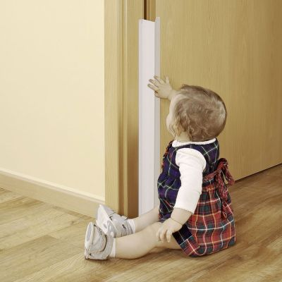 Reer Adjustable Finger Protection for Doors (7060) protects baby fingers from getting trapped by a door hinge