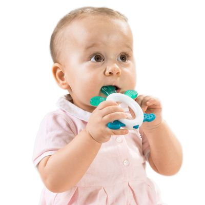 Teething baby biting on a Reer Cool & Play Cooling Teether with Rattle