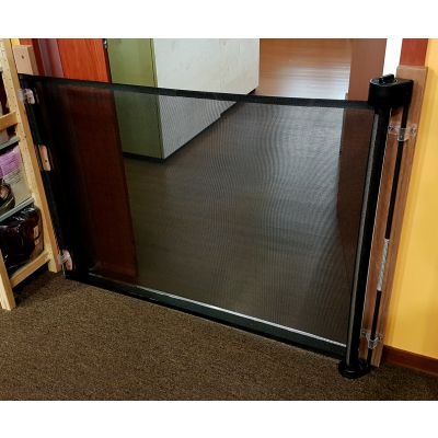 Smart Retract Retract-A-Gate Retractable Baby & Pet Safety Gate in black used at a doorway