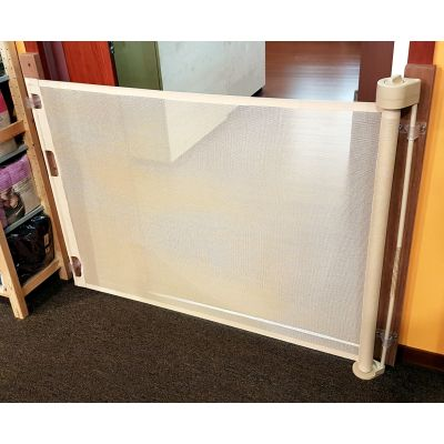Smart Retract Retract-A-Gate Retractable Baby & Pet Safety Gate in cafe color used at a doorway