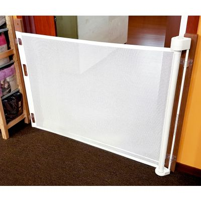 Smart Retract Retract-A-Gate Retractable Baby & Pet Safety Gate in white color used at a doorway