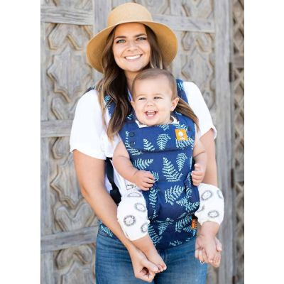 Baby faces outwards in a Tula Explore Everblue baby carrier