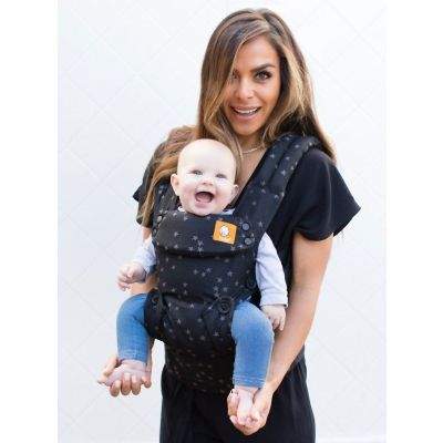 Mom puts baby in front facing position in a Tula Explore Discover Baby Carrier