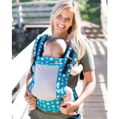 Lady front carries baby in a Tula Free To Grow Baby Carrier Coast Aurora