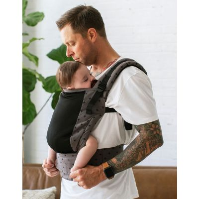 Tula Free-To-Grow Baby Carrier Coast Mason by father carrying sleeping baby