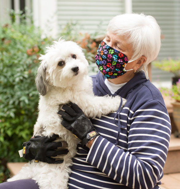 Old lady with her dog wearing a BreatheHealthy Paws 2 Face Mask