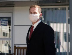 Man on business trip wearing a Breathe Healthy Anti Microbial Face Mask